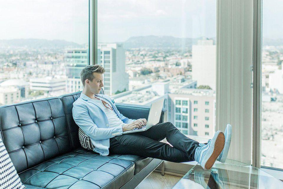 millennial man working on his laptop